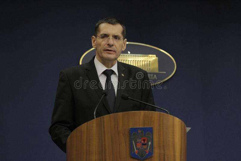 Petre Toba, Minister of Internal Affairs press conference. BUCHAREST, ROMANIA - DECEMBER 23, 2015: Petre Toba, Minister of Internal Affairs speaks during a press stock photography
