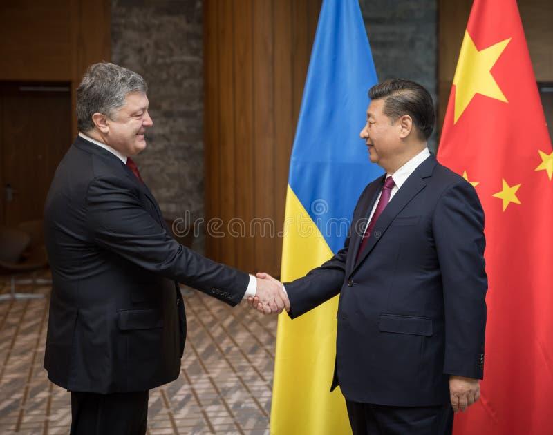 Petro波罗申科和习近平 免版税库存照片