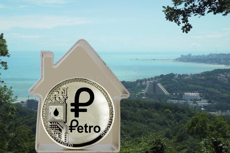 Petro coin in a metal house stock image
