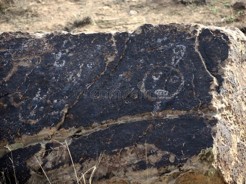 Petro glyphs on  rock. People who lived in the area left their mark as etchings on rocks. The rock art seen in the painted desert shows images of the world the royalty free stock photography