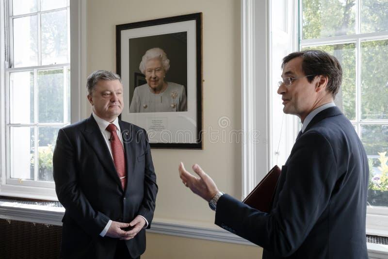 Petro Poroshenko at Royal Institute of International Affairs Chatham House. LONDON, UK - Apr 19, 2017: President of Ukraine Petro Poroshenko near British Queen stock photography
