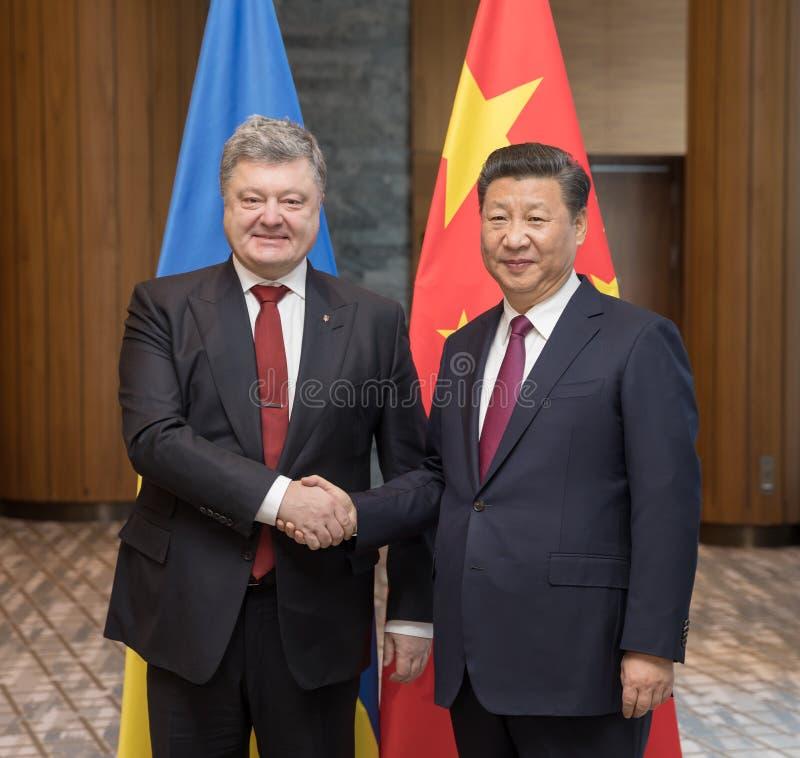 Petro Poroshenko and Xi Jinping. DAVOS, SWITZERLAND - Jan 17, 2017: President of Ukraine Petro Poroshenko and President of the Peoples Republic of China Xi stock photos