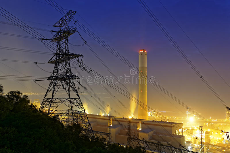 Petrochemical industrial power plant factory. At night royalty free stock photo