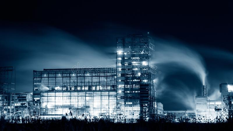 Petrochemical plant in night. Monochrome photography stock photo