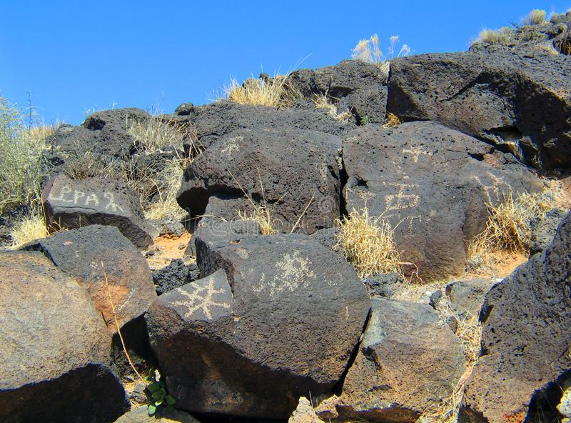 Petroglyph National Monument in New Mexico. Beyond the Rio Grande, Albuquerque is bordered on the west side by a low, barren, volcanic plateau West Mesa - 200 royalty free stock photos