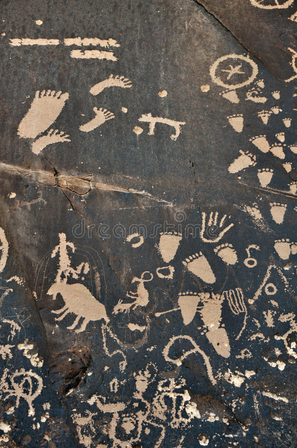 Petroglyph on Rock. Petroglyph on Newspaper Rock. The rock is located by State Route 211 in Utah stock photography