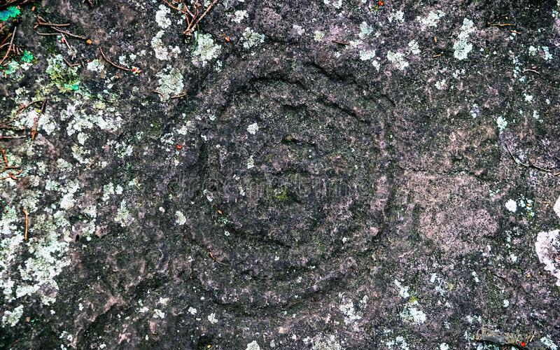Petroglyphs antigos cinzelados pelos tribos B do Carib fotografia de stock