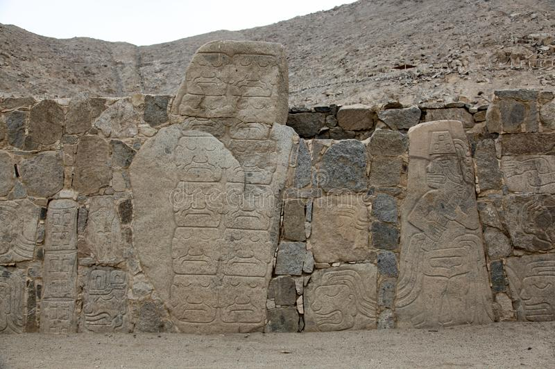 Petroglyphs or carved stones. In the prehistoric settlement of Casma, Peru stock photography