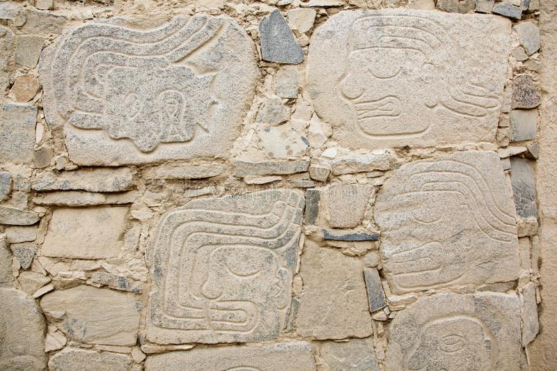 Petroglyphs or carved stones. In the prehistoric settlement of Casma, Peru royalty free stock image