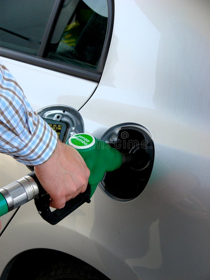 Download Petrol pump filling stock photo. Image of record, person - 5191668