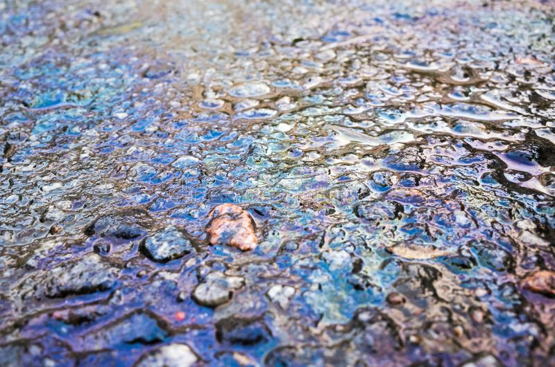 Petrol spill on asphalt road, close up royalty free stock photos