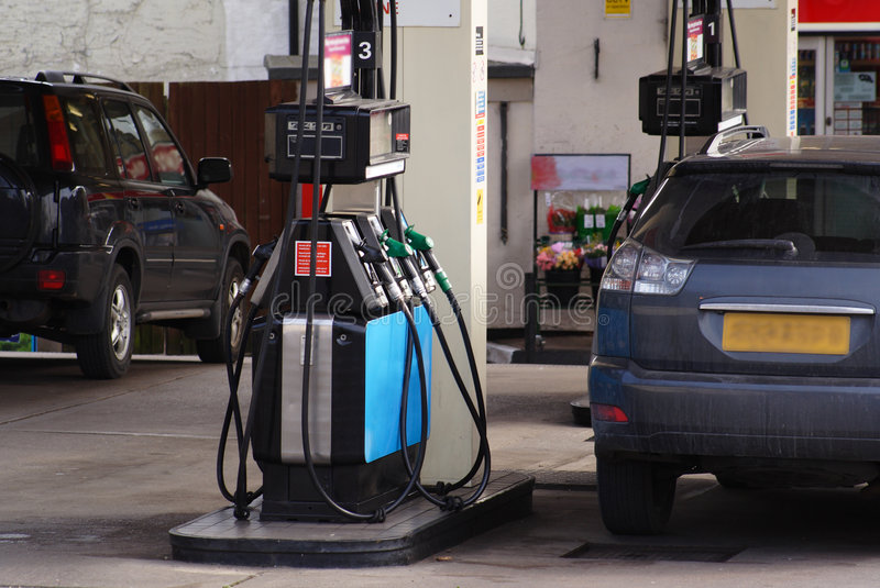 Petrol station. Petrol pumps on garage forecourt royalty free stock photography