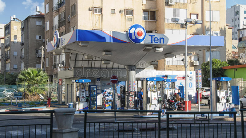 Petrol station Ten in the city center. Rishon LeZion, Israel - January 12, 2016: Petrol station Ten in the city center. There are two unidentified workers in royalty free stock photos