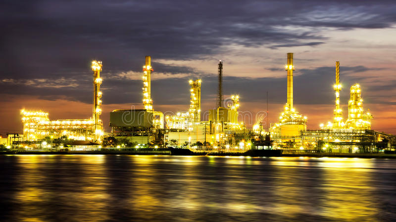 Petroleum oil refinery factory over sunrise. In Bangkok, Thailand stock photography
