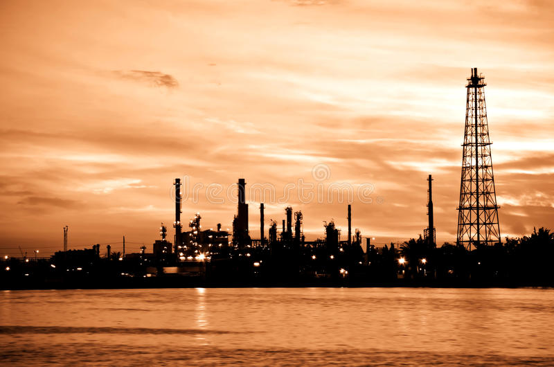 Petroleum oil refinery factory over sunrise. Silhouette of Petroleum oil refinery factory over sunrise in Bangkok, Thailand royalty free stock photo
