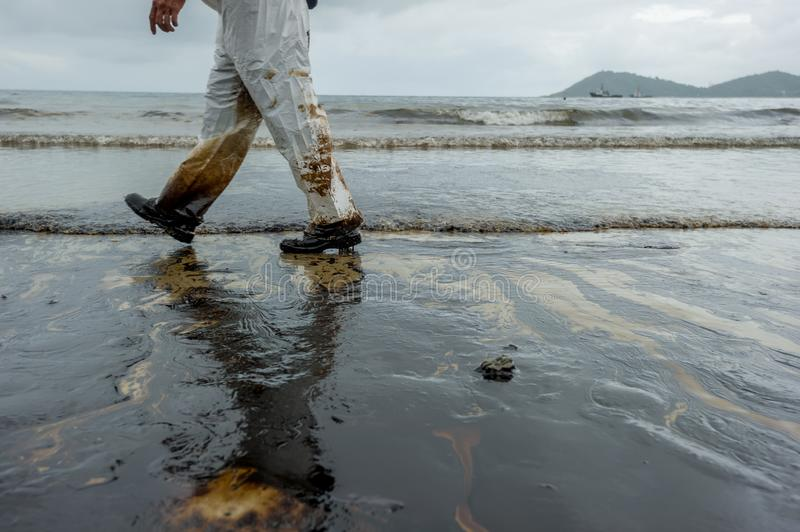 Petroleum spill mixed with other chemical substances on sea and sand surface. Pollution images, Samet Island, Thailand.  royalty free stock image