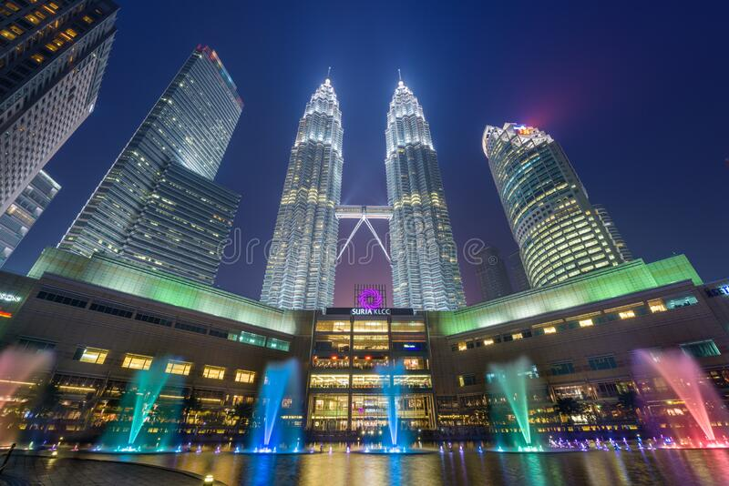 The Petronas Towers viewed from KLCC Park at twilight royalty free stock images