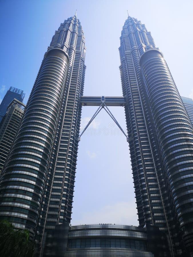 Petronas twin towers, KLCC, in Kuala Lumpur, Malaysia. On blue sky stock photo