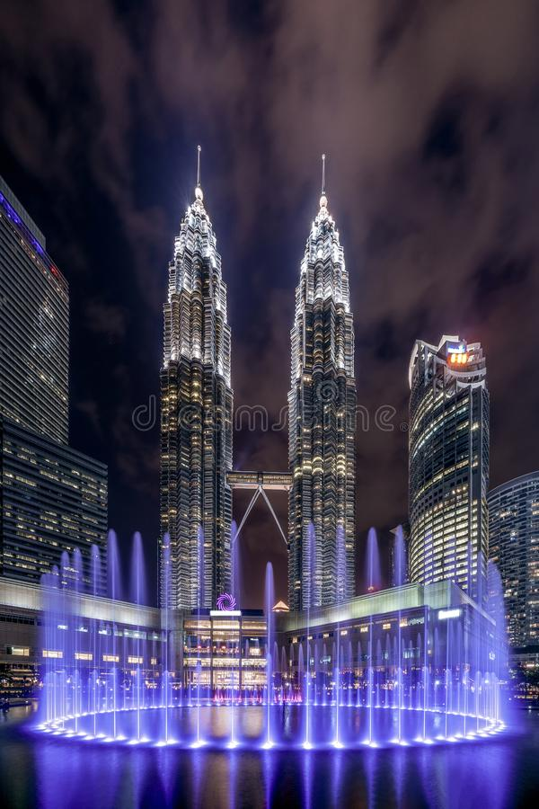 Petronas Twin Towers in Kuala Lumpur Downtown with fountain shows, Malaysia. Financial district and business centers in smart stock image