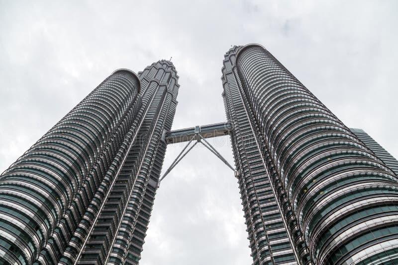 Petronas Twin Towers, Kuala Lumpur, Malaysia. The Petronas Twin Towers as seen from the ground in Kuala Lumpur, Malaysia are the world's tallest twin tower. The stock photo