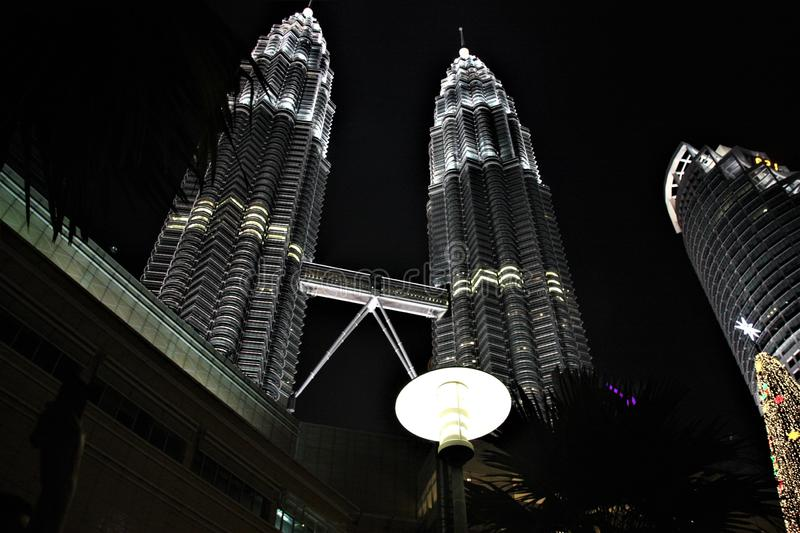 The Petronas Twin Towers at night, tallest twin towers in the world at Kuala Lumpur Malaysia. The Petronas Towers, also known as the Petronas Twin Towers, are royalty free stock images