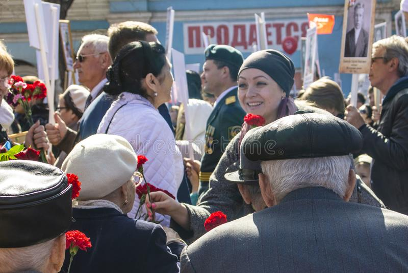 PETROPAVLOVSK MAY 9, 2018: residents in memorable procession. `An immortal regiment`, on May 9, 2018 . Kazakhstan Petropavlovs royalty free stock image