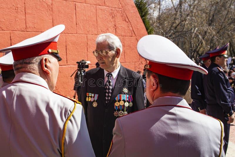 PETROPAVLOVSK MAY 9, 2018: residents in memorable procession. `An immortal regiment`, on May 9, 2018 . Kazakhstan Petropavlovs royalty free stock photos