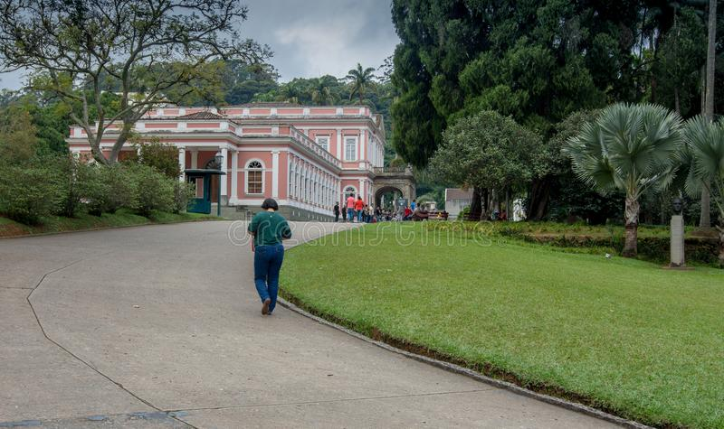 Museu Imperial de Petrópolis. Petropolis, Rio de Janeiro, Brazil- May 17, 2018: Groups of students marching towards the Imperial Museum, to learn about the stock images