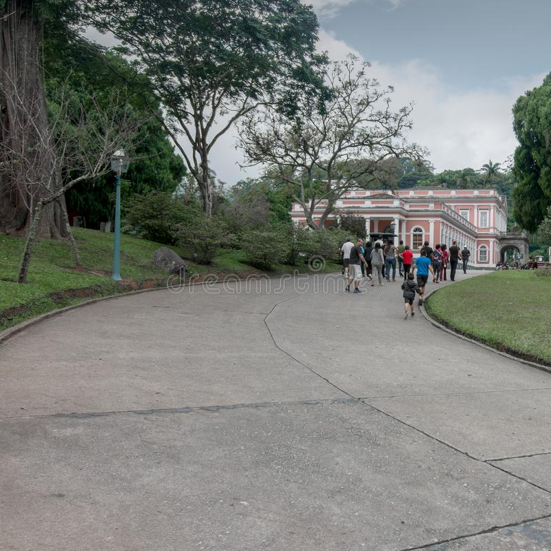 Museu Imperial de Petrópolis. Petropolis, Rio de Janeiro, Brazil- May 17, 2018: Groups of students marching towards the Imperial Museum, to learn about the royalty free stock images