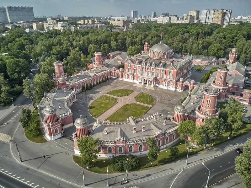 Petrovsky Palace on Leningradskii avenue in sping day. Aerial drone view. Moscow, Russia stock photography