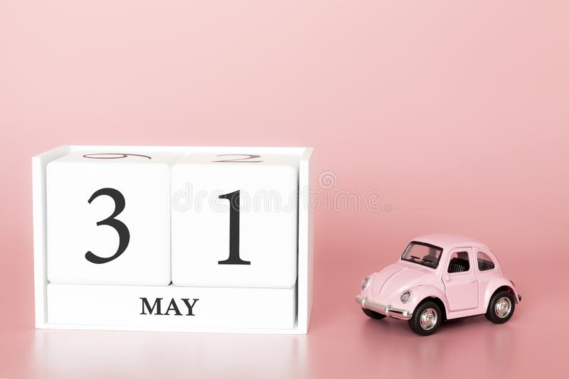 Petrozavodsk, Russia - April 06, 2019: Close-up wooden cube 31st of May. Day 31 of may month, calendar on a pink background with. Retro car. Spring time. Empty stock photo