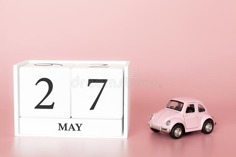 Petrozavodsk, Russia - April 06, 2019: Close-up wooden cube 27th of May. Day 27 of may month, calendar on a pink background with. Retro car. Spring time. Empty royalty free stock photos