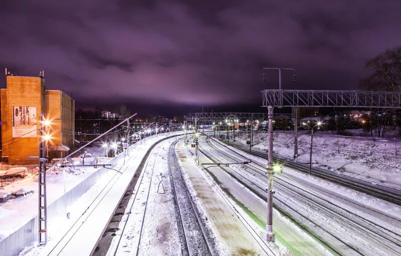 Petrozavodsk, Russia - January 07, 2019: Railway tracks at night on the platform of Russian Railways stock photography