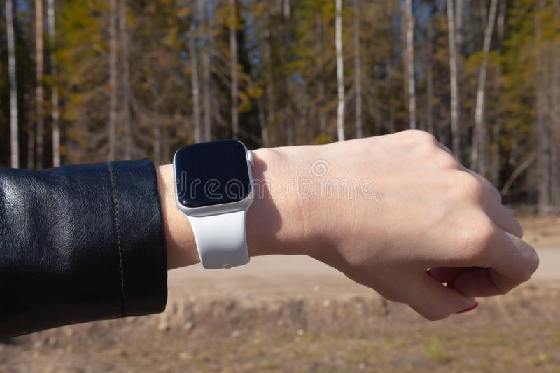 Modern smart watch on a girl's hand stock images