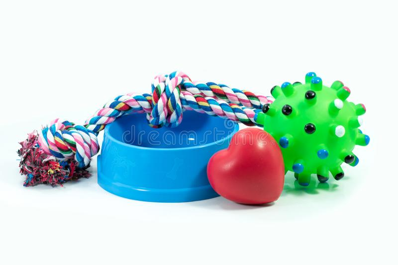 Pets are friends concept. Pet bowl and rubber toys royalty free stock photo