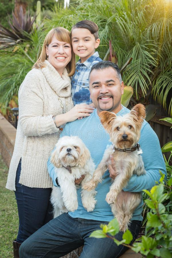 Pets with Mixed Race Family Portrait Outdoors. Happy Mixed Race Family Portrait Outdoors royalty free stock images