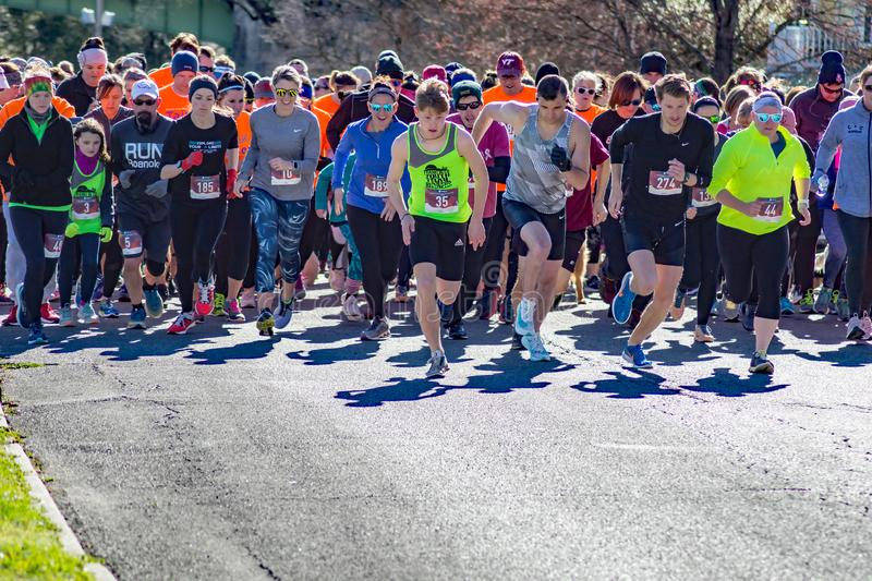Pets, Walkers, Runners at the Starting Line. Roanoke, VA – March 23rd: A large of group of runners, walkers and their pet dogs at the starting line at the royalty free stock images