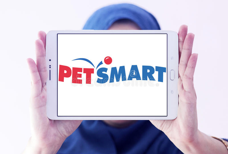 PetSmart retailer logo. Logo of PetSmart on samsung tablet holded by arab muslim woman. PetSmart is an American retail chain operating in the United States royalty free stock images