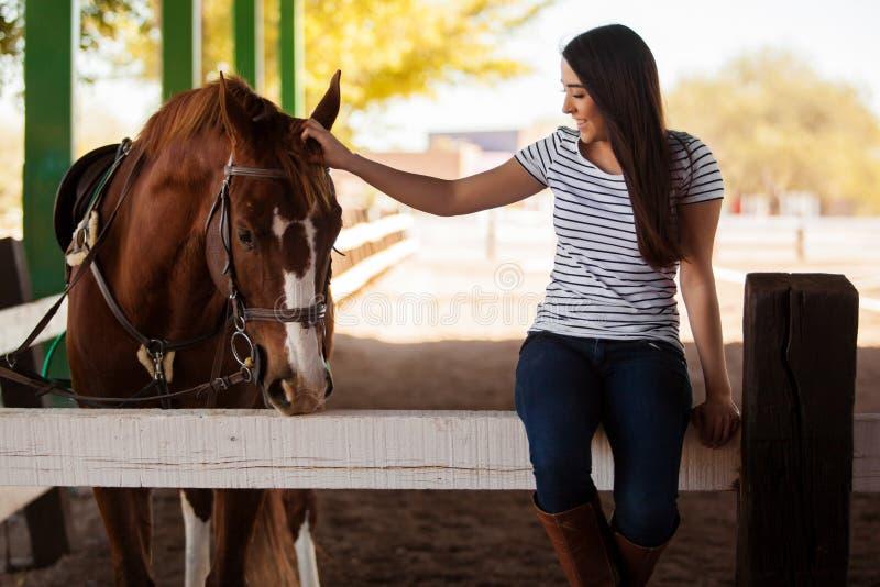 Petting my horse at a ranch royalty free stock photos
