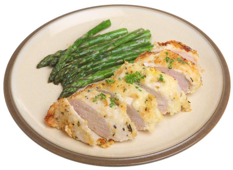 Petto di pollo al forno con il limone, il parmigiano e le erbe fotografia stock libera da diritti