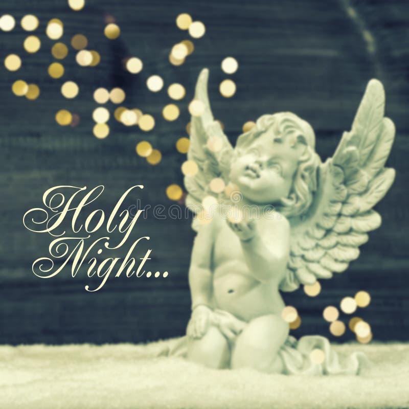 Peu d'ange gardien avec les lumières brillantes Décoration de Noël image stock