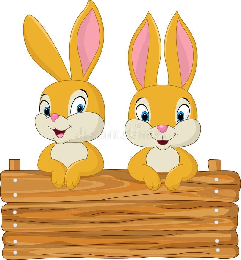 Peu de lapin tenant le signe en bois illustration stock