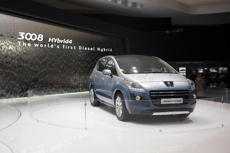 Peugeot 3008 HYbrid4. World premiere of the Peugeot 3008 HYbrid4 at the 2011 edition of the Geneva Motorshow. This is the world's first diesel hybrid vehicle stock photo