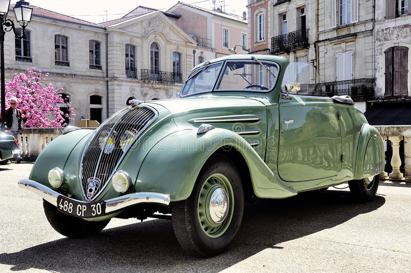 Peugeot 302 manufactured from 1936 to 1938. Photographed the rally of vintage cars Town Hall Square in the town of Ales, in the Gard department royalty free stock photo