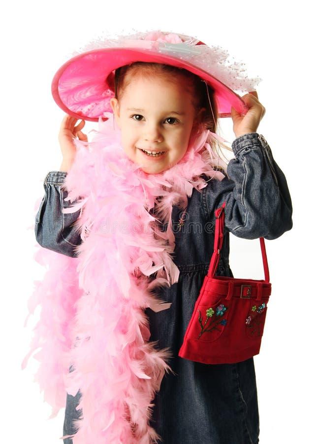 Peuter meisje het spelen kleding omhoog royalty-vrije stock foto's