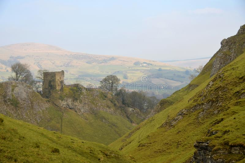 Peveril Castle in The Peak District National ParK. Peveril Castle, a ruined 11th-century castle overlooking the village of Castleton in the English county of royalty free stock photo