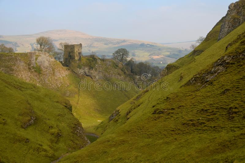 Peveril Castle in The Peak District National Park. Peveril Castle, a ruined 11th-century castle overlooking the village of Castleton in the English county of stock image