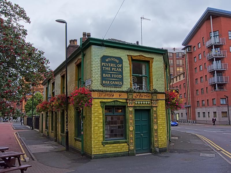 Peveril of the peak - famous pub in Manchester. Peveril of the peak , iconic old pub, painted in yellow and green in Manchester stock photos