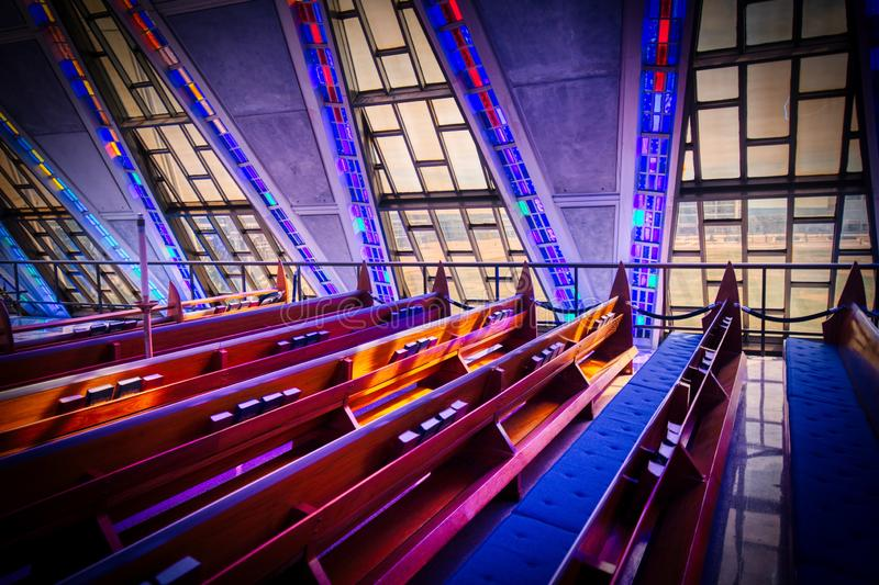 Pews, Windows and Stained Glass Light and Shadows at the Air Force Academy Chapel. Pews. hymnals and beautiful windows in the Protestant Chapel of the Air Force royalty free stock photography