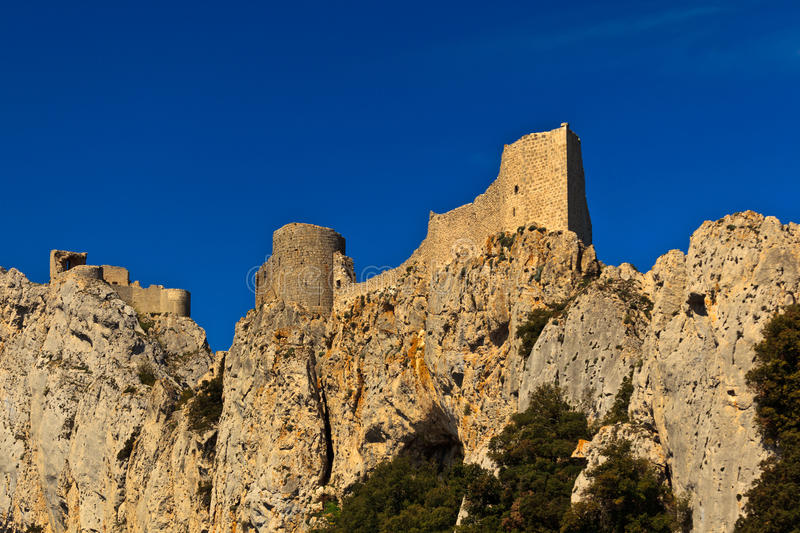 Peyrepertuse cathar castle ramparts and tower. Closeup of the ramparts and tower of Peyrepertuse, a 12th century medieval stone cathar castle, in the Pyrenees stock photo
